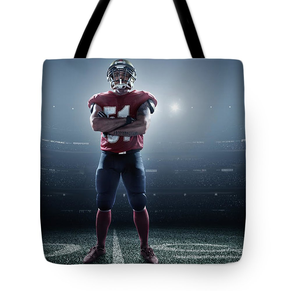 Soccer Uniform Tote Bag featuring the photograph American Football In Action by Dmytro Aksonov