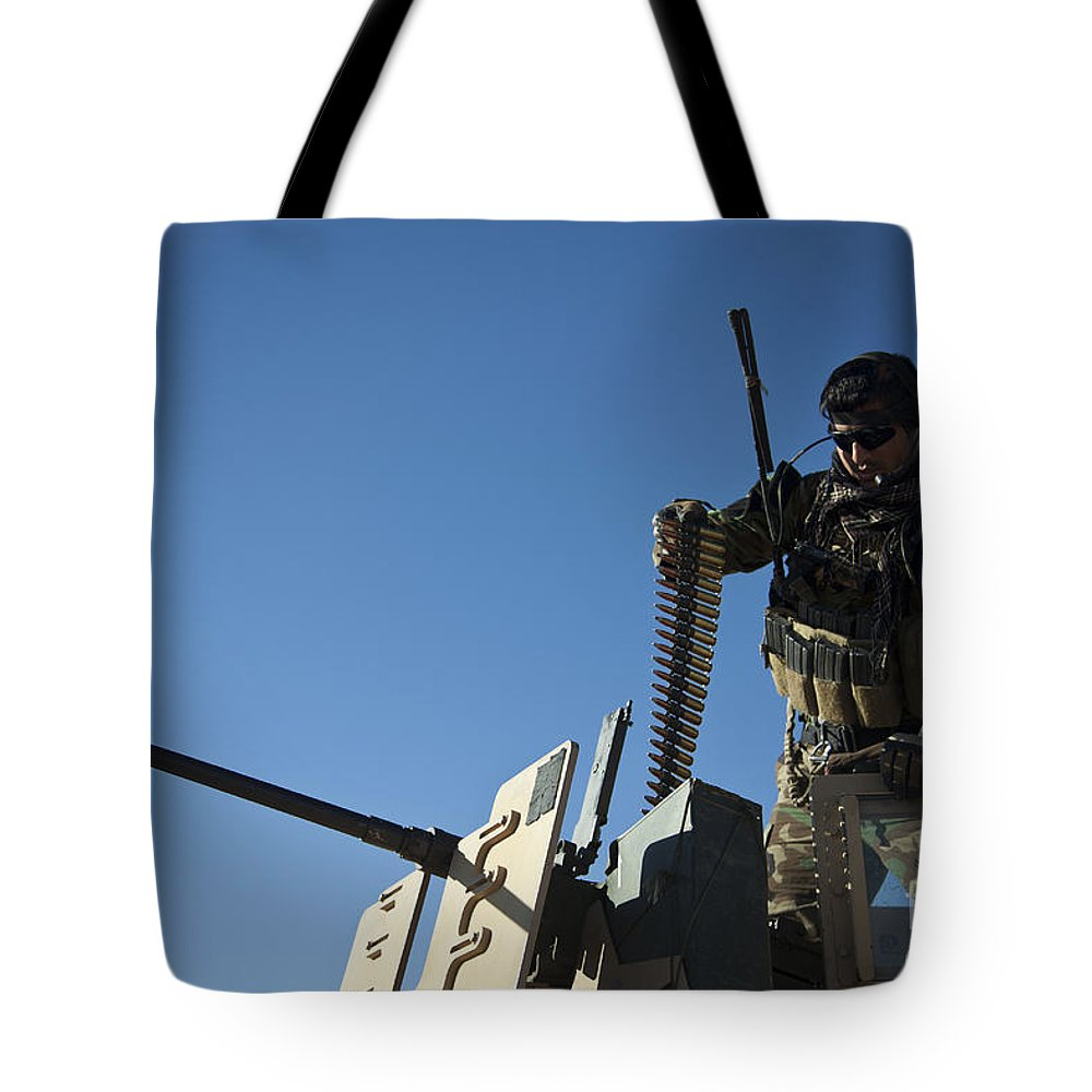 Afghanistan Tote Bag featuring the photograph An Afghan National Army Soldier by Stocktrek Images