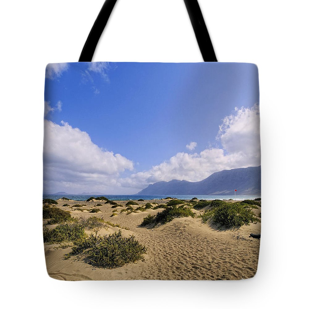 Beach Tote Bag featuring the photograph Caleta De Famara Beach On Lanzarote by Karol Kozlowski