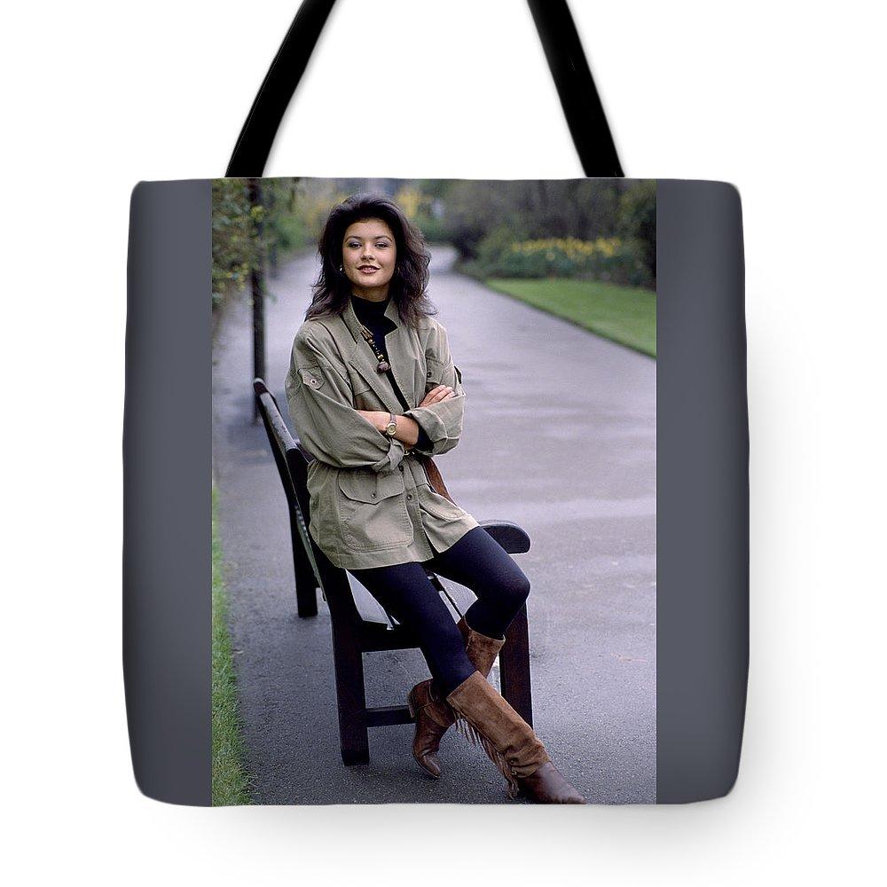 Catherine Zeta Jones Tote Bag featuring the photograph Catherine Zeta Jones by Shaun Higson