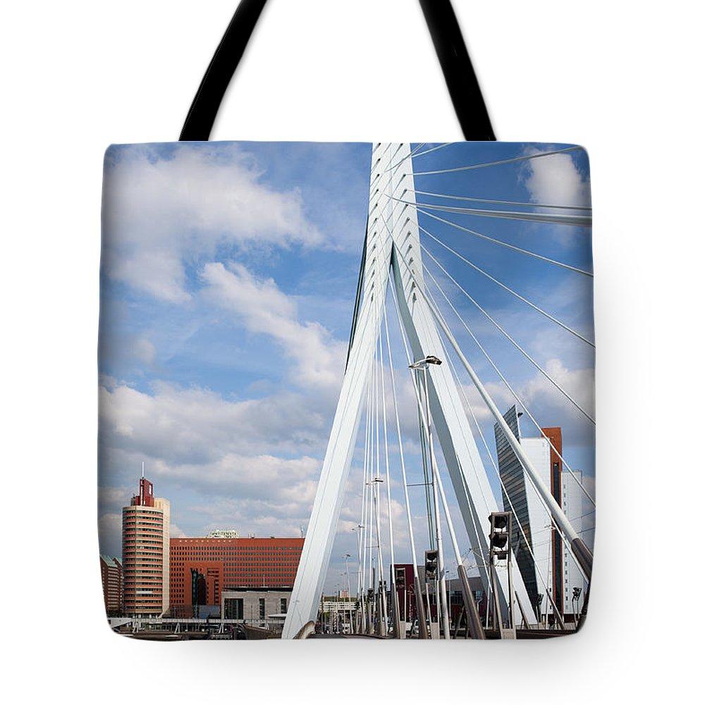 Rotterdam Tote Bag featuring the photograph Erasmus Bridge In Rotterdam by Artur Bogacki