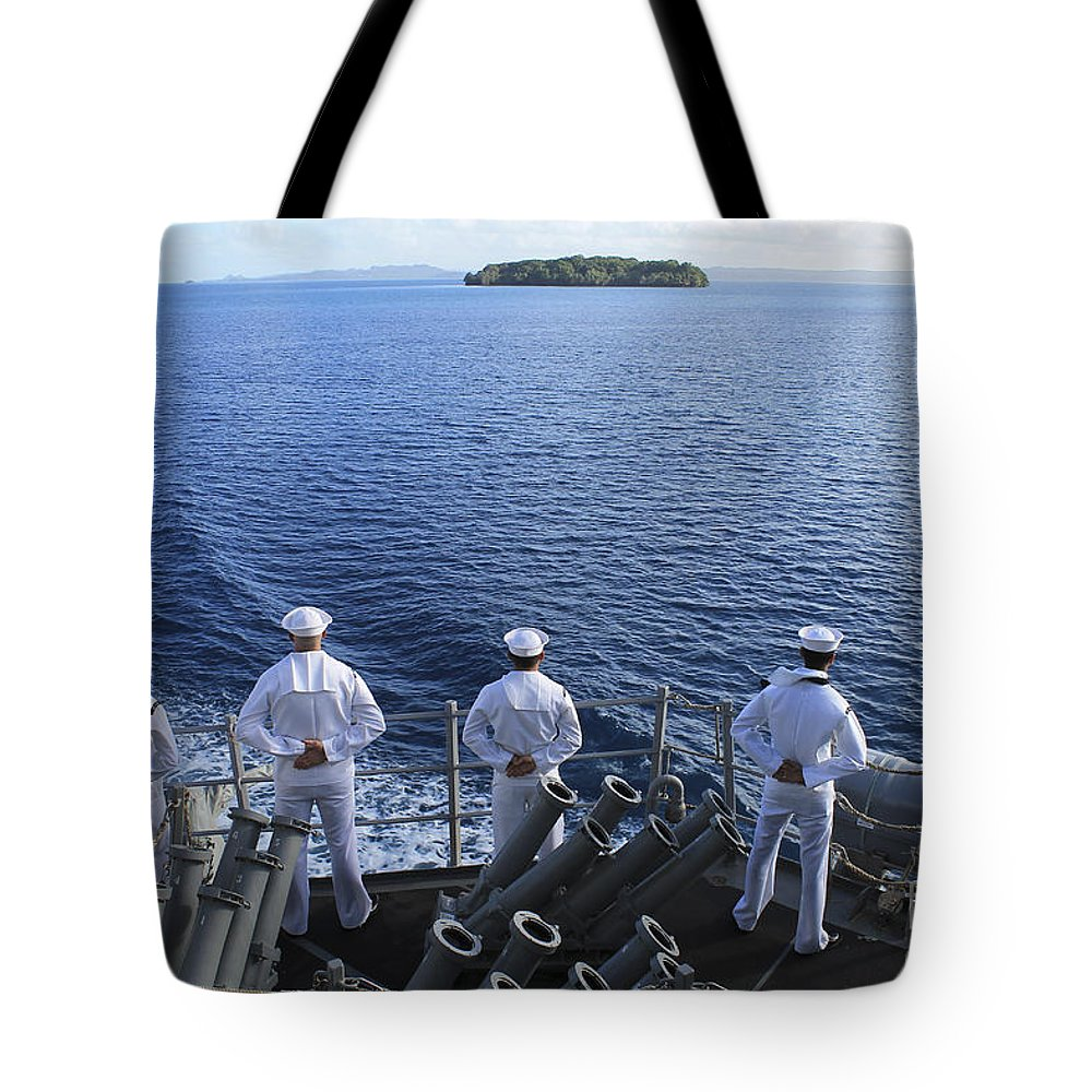Military Tote Bag featuring the photograph Sailors Man The Rails Aboard by Stocktrek Images