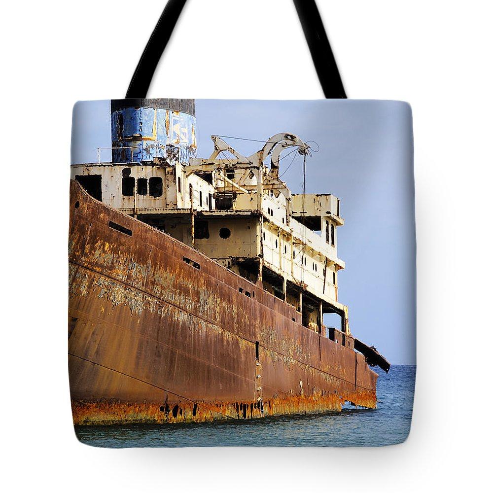 Boat Tote Bag featuring the photograph Shipwreck On Lanzarote by Karol Kozlowski