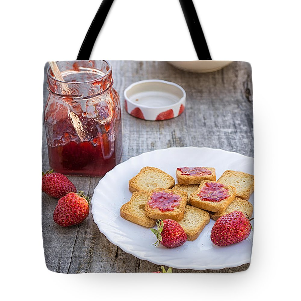 Strawberry Tote Bag featuring the photograph Strawberry by Paulo Goncalves