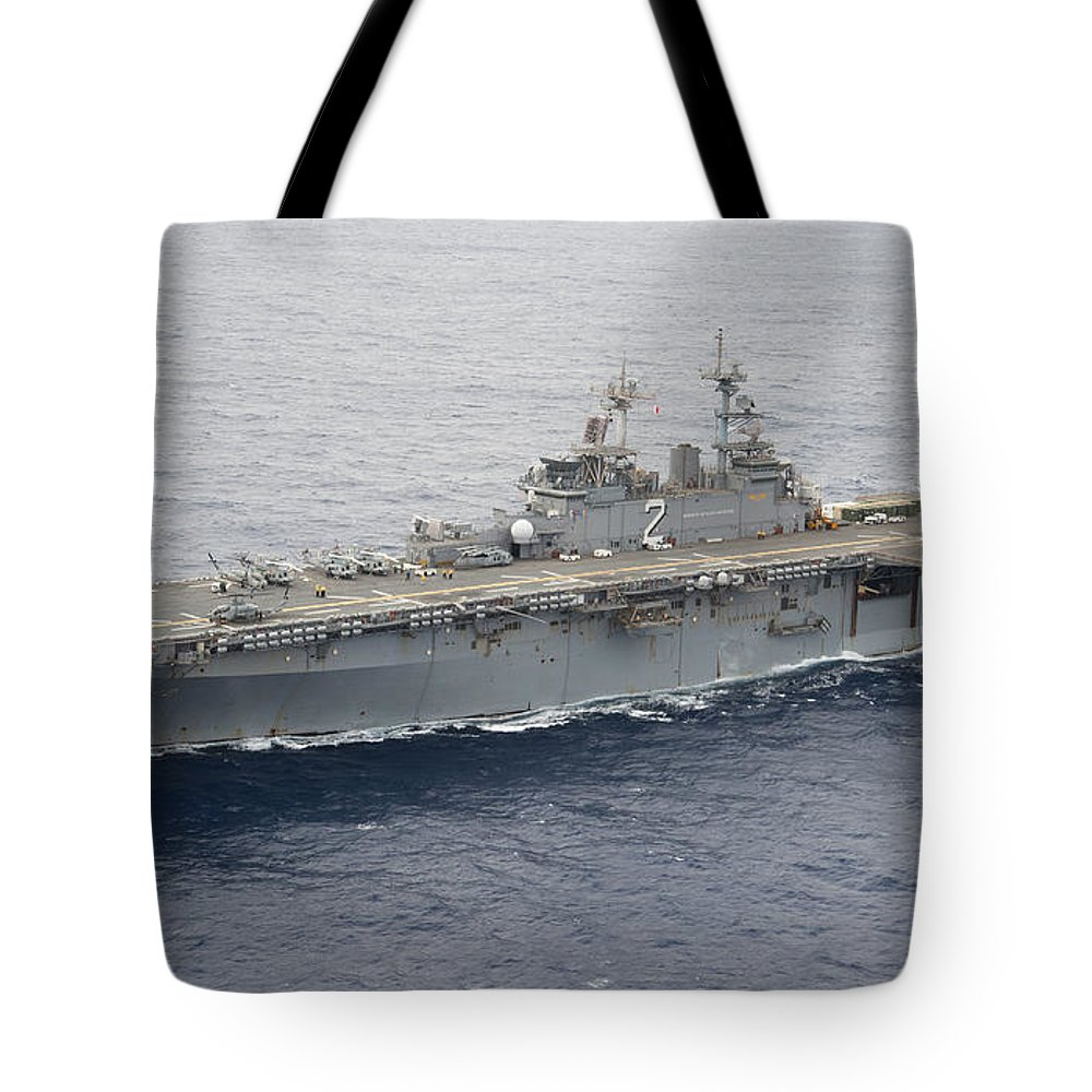 Uss Essex Tote Bag featuring the photograph The Amphibious Assault Ship Uss Essex by Stocktrek Images