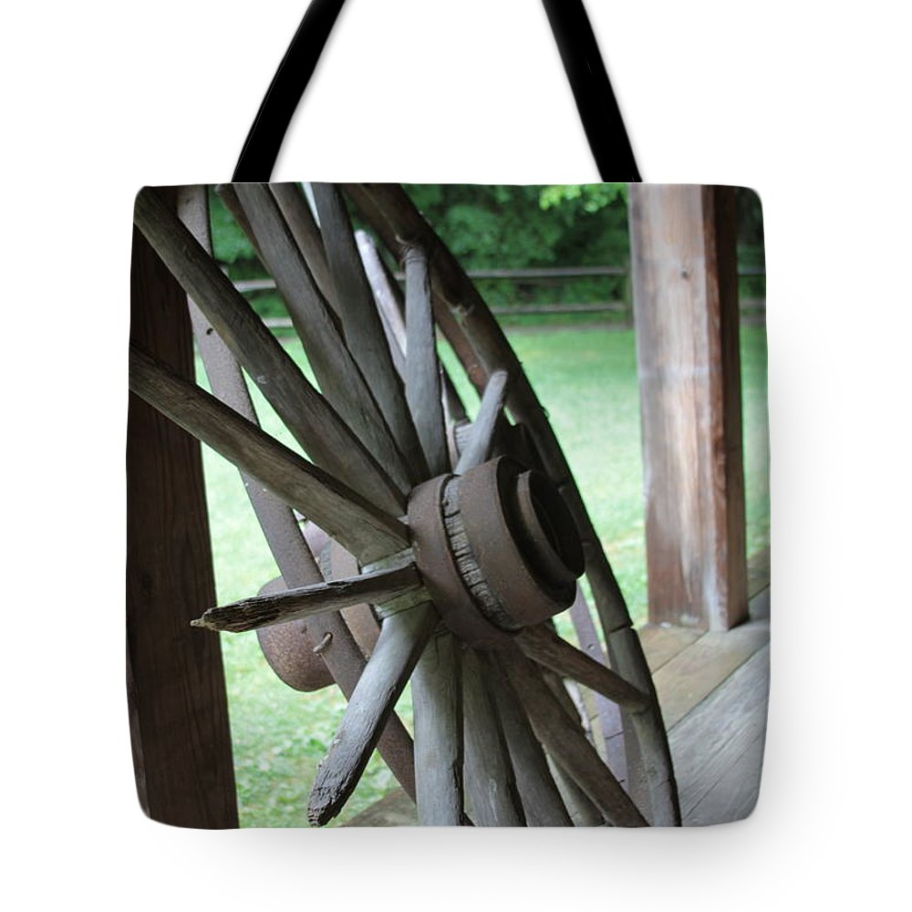 Wagon Tote Bag featuring the photograph Wagon Wheel by Dwight Cook