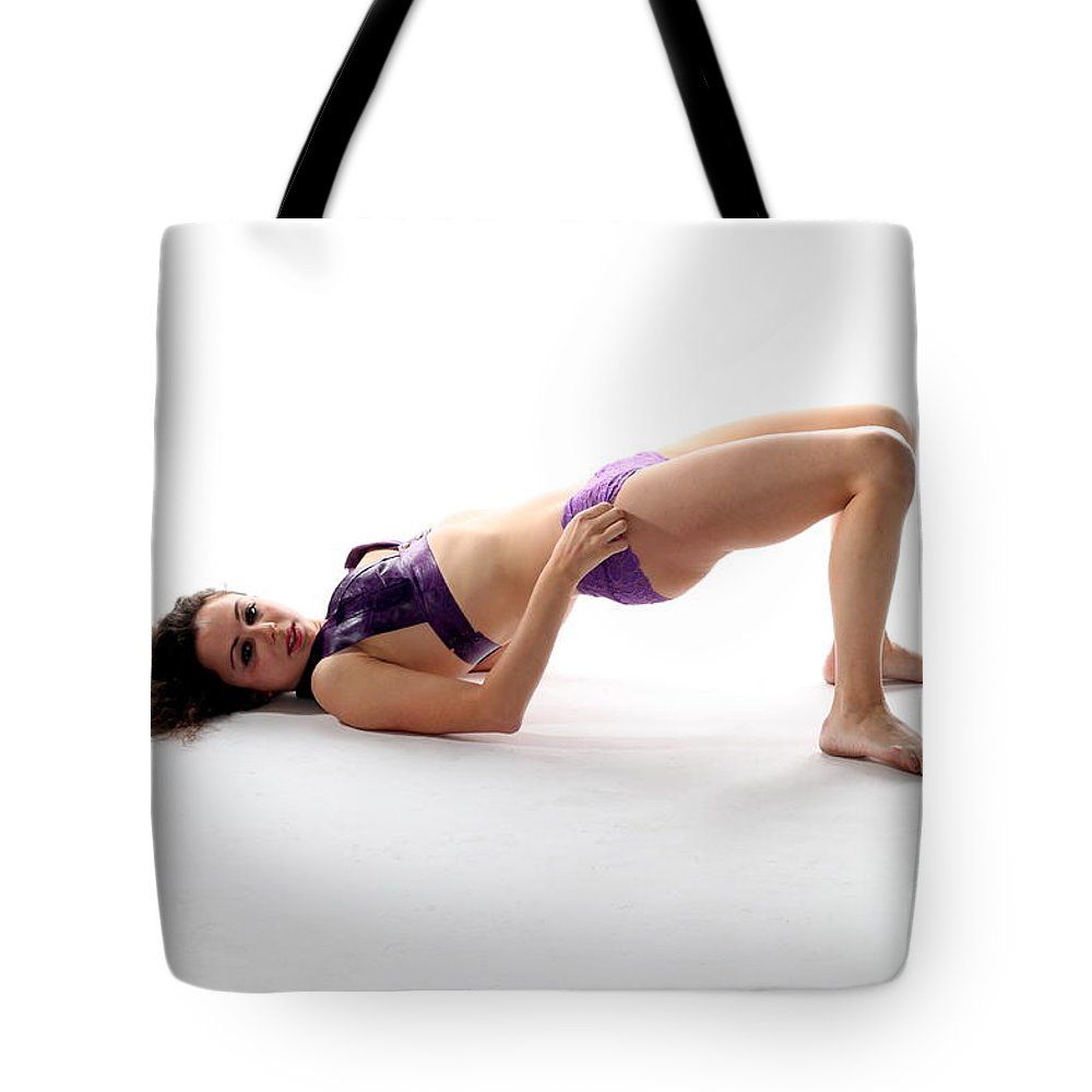 Female Tote Bag featuring the photograph Woman Posing by Henrik Lehnerer
