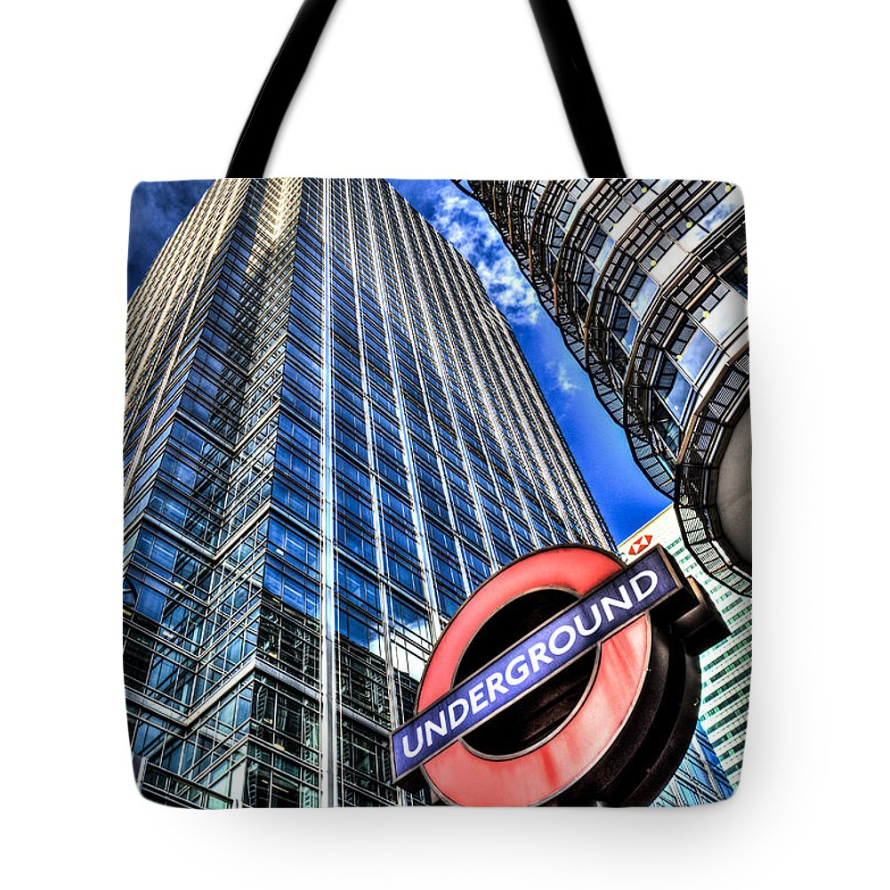 Taxi Taxis Tote Bag featuring the photograph Canary Wharf London by David Pyatt