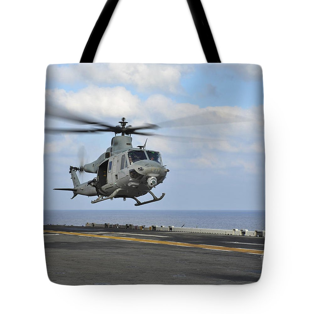 Military Tote Bag featuring the photograph Aviation Boatswains Mate Directs by Stocktrek Images