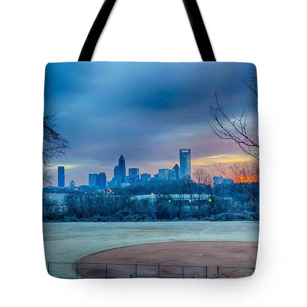 Charlotte Tote Bag featuring the photograph Charlotte The Queen City Skyline At Sunrise by Alex Grichenko