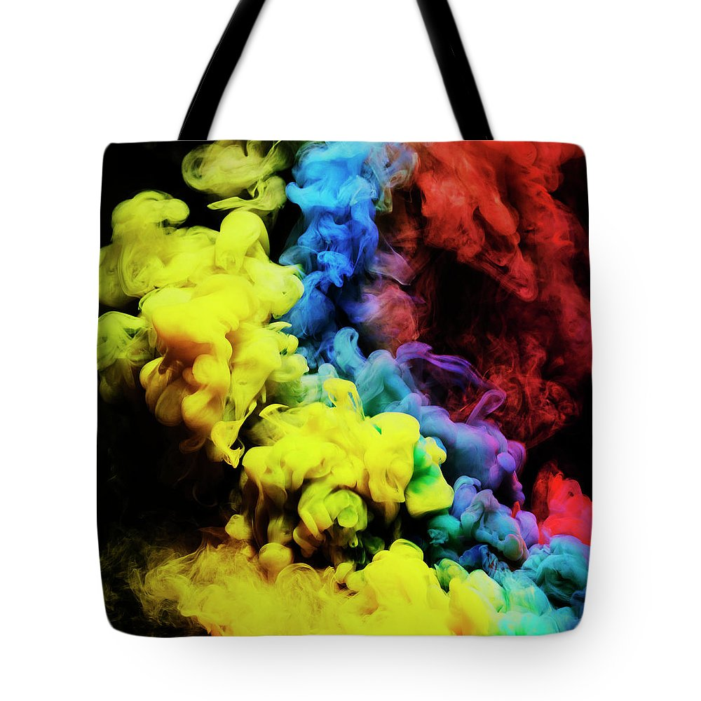 Copenhagen Tote Bag featuring the photograph Coloured Smoke Mixing In Dark Room by Henrik Sorensen