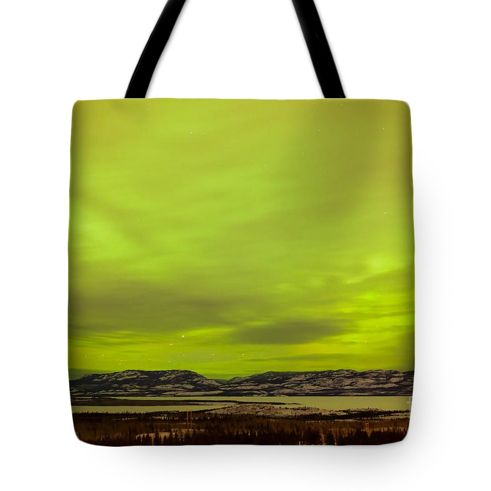 Alaska Tote Bag featuring the photograph Green Glow Of Northern Lights Or Aurora Borealis by Stephan Pietzko