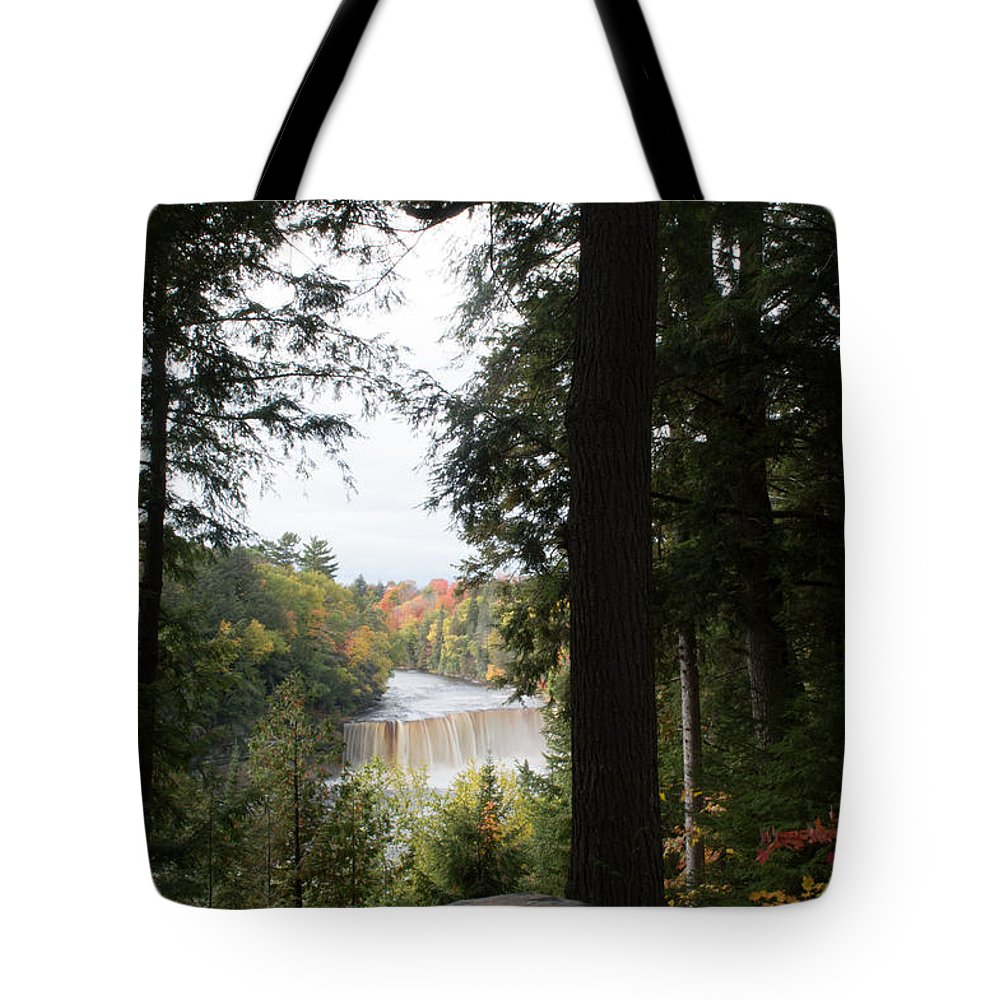 Upper Tahquamenon Falls Tote Bag featuring the photograph Looking Out by Linda Kerkau