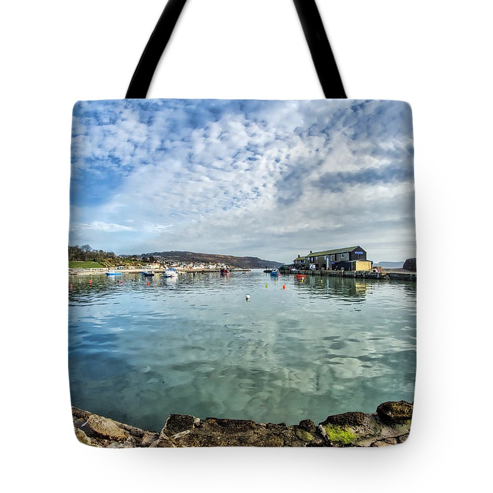 Alto-cumulus Tote Bag featuring the photograph Lyme Regis Harbour by Susie Peek