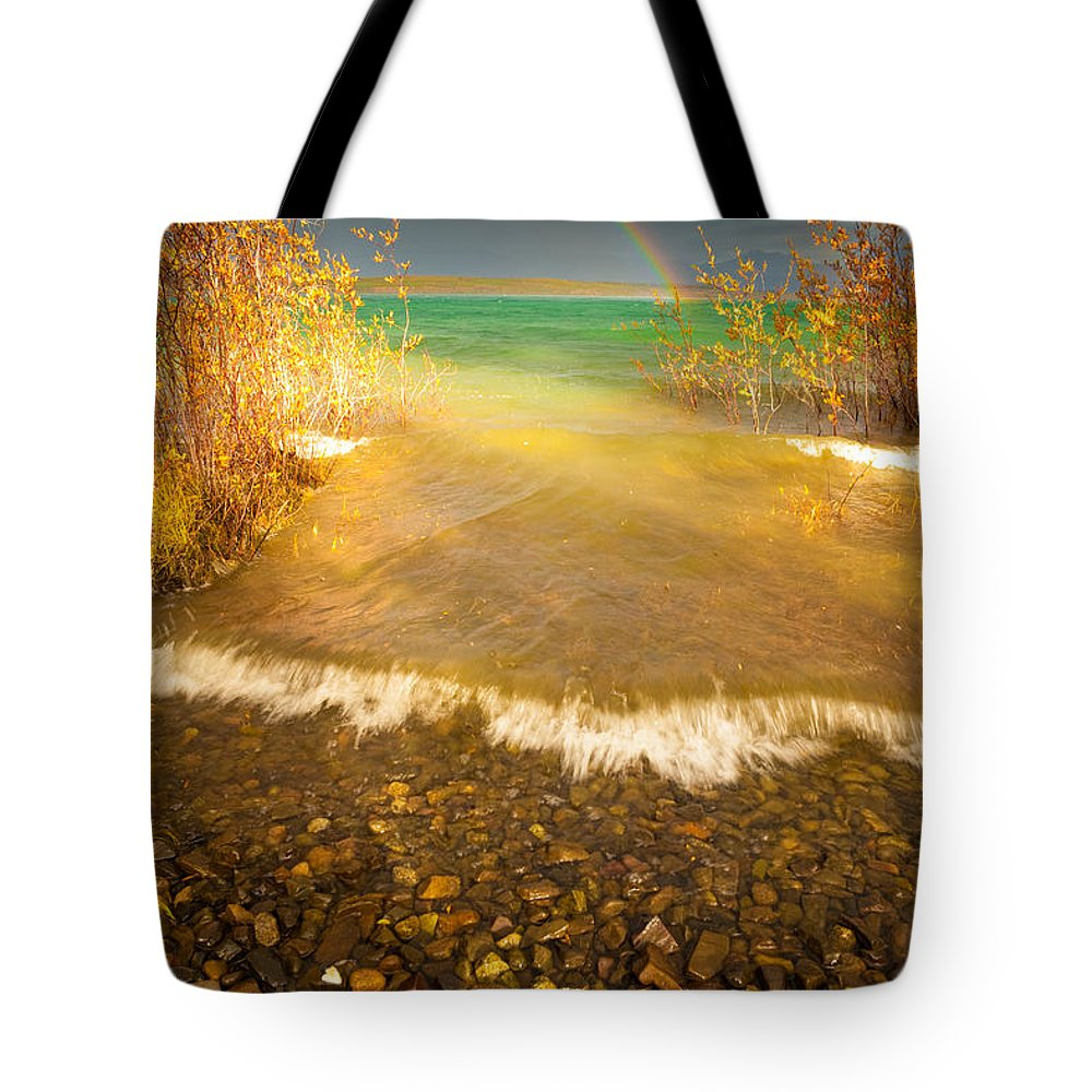Adventure Tote Bag featuring the photograph Rainbow And Dark Clouds Over Large Lake by Stephan Pietzko