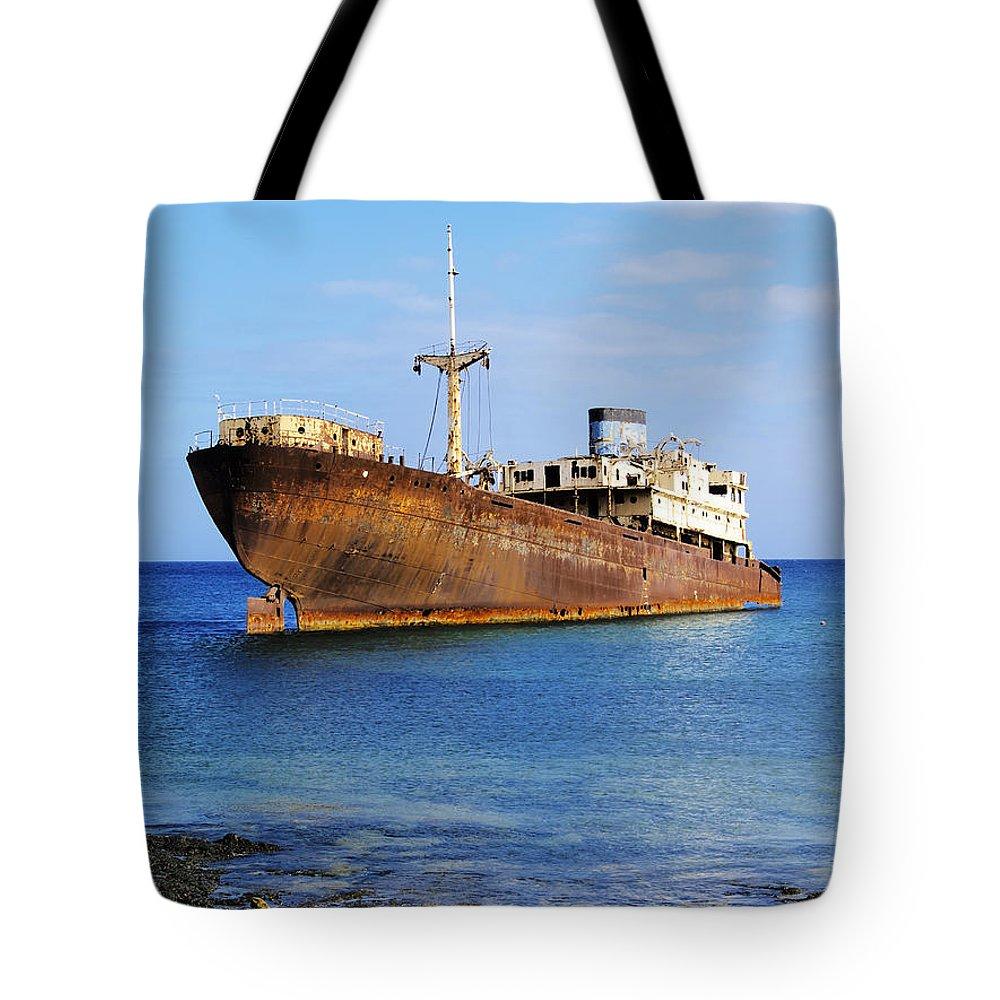 Wreck Tote Bag featuring the photograph Shipwreck On Lanzarote by Karol Kozlowski