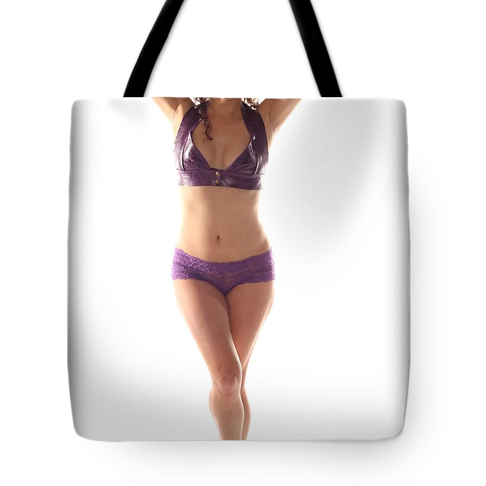 Standing Tote Bag featuring the photograph Woman Posing by Henrik Lehnerer