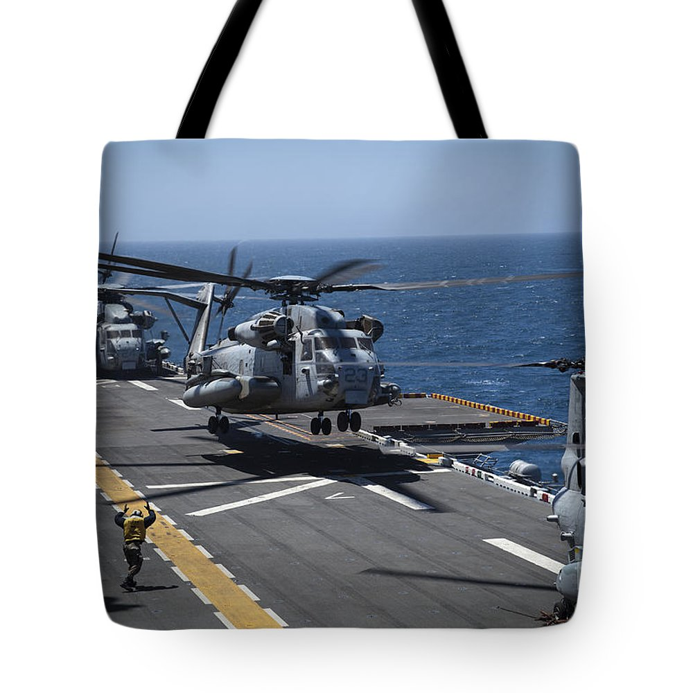 Military Tote Bag featuring the photograph A Ch-53e Super Stallion Helicopter by Stocktrek Images