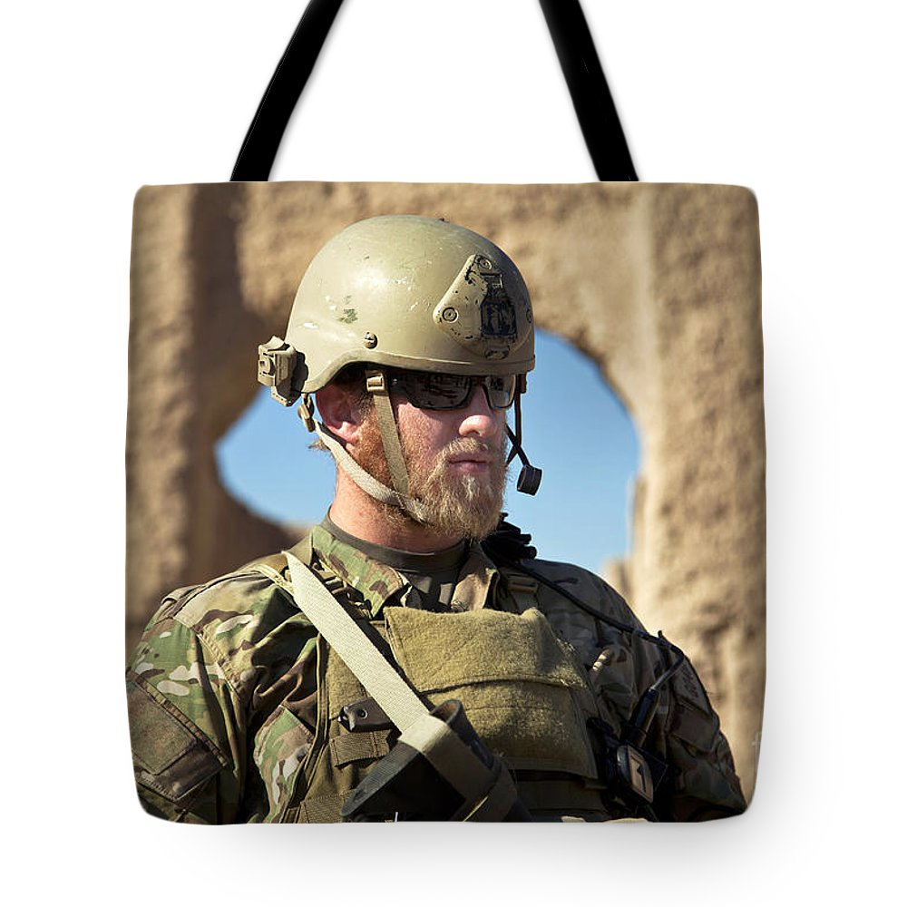 Afghanistan Tote Bag featuring the photograph A Coalition Force Member Maintains by Stocktrek Images