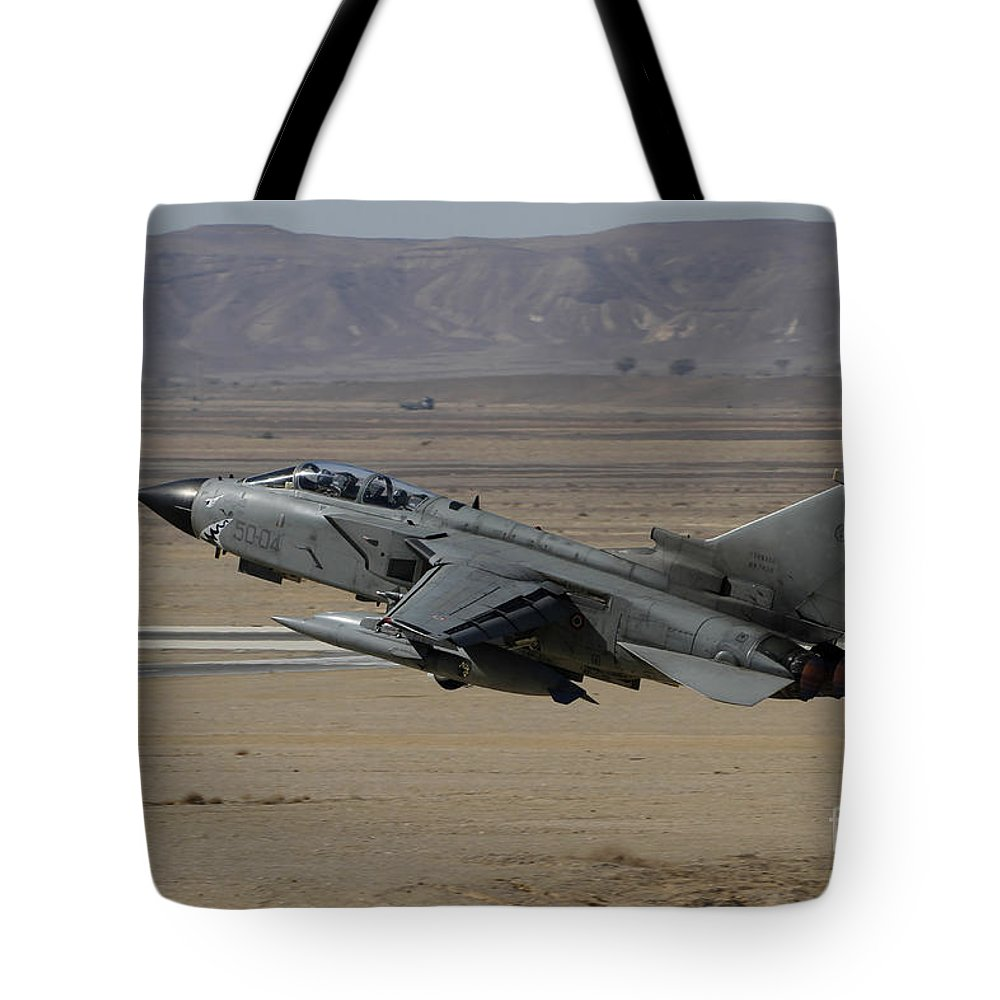 Military Tote Bag featuring the photograph A Panavia Tornado Of The Italian Air by Ofer Zidon
