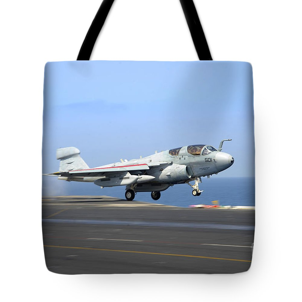 Military Tote Bag featuring the photograph An Ea-6b Prowler Launches by Stocktrek Images