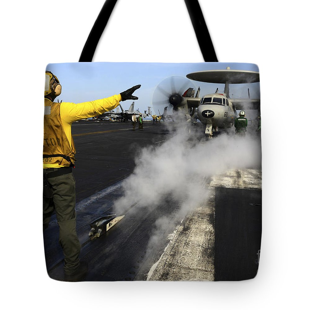 Operation Enduring Freedom Tote Bag featuring the photograph Aviation Boatswains Mate Directs An by Stocktrek Images