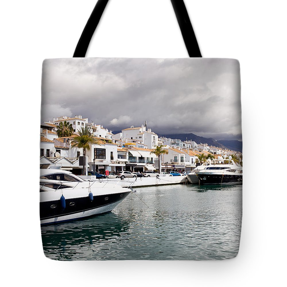 Andalucia Tote Bag featuring the photograph Puerto Banus In Spain by Artur Bogacki