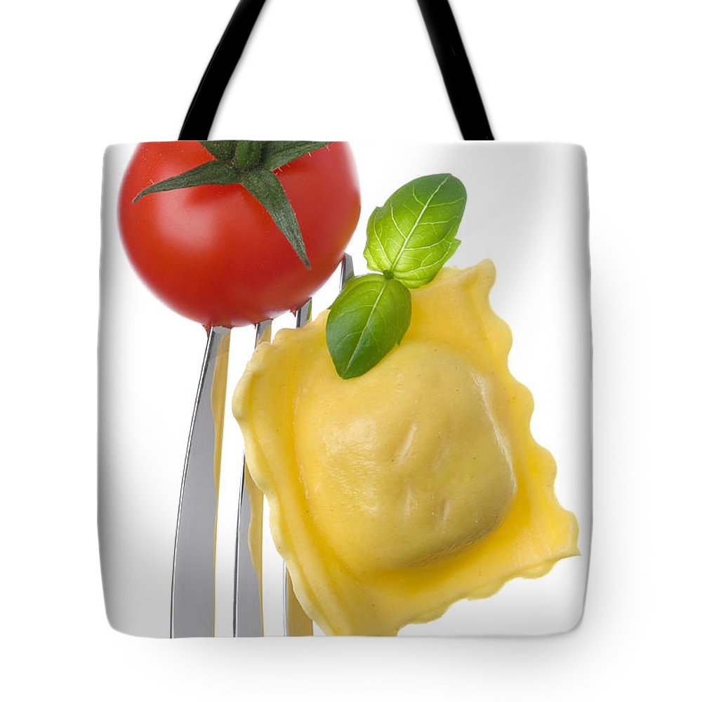 Pasta Tote Bag featuring the photograph Ravioli Pasta Tomato And Basil On Fork Against White Background by Lee Avison
