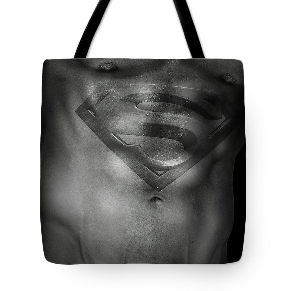 Superman Tote Bag featuring the photograph Superman by Mark Ashkenazi