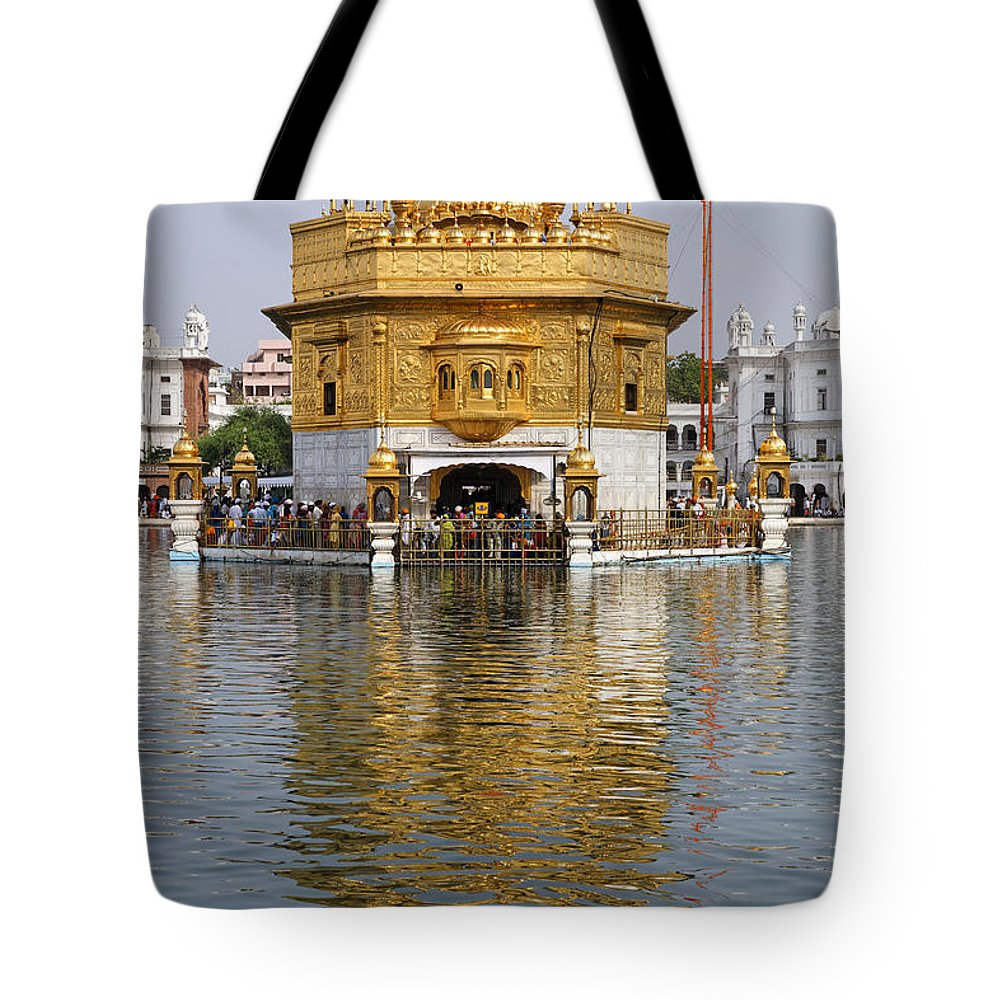 Amritsar Tote Bag featuring the photograph The Golden Temple At Amritsar India by Robert Preston