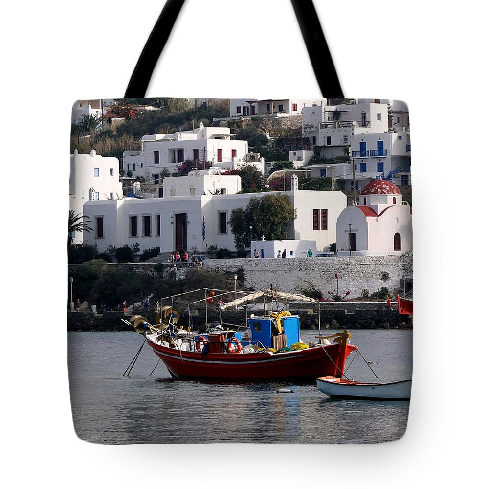 The Greek Isles Tote Bag featuring the photograph A Boat In The Harbor Of Mykonos Greece by Richard Rosenshein