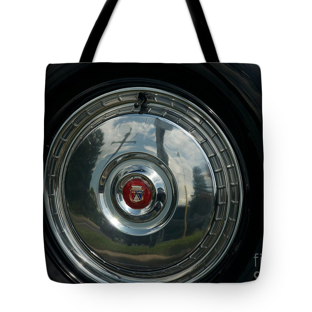 Car Tote Bag featuring the photograph 56 Ford Thunderbird Spare Hub Cap by Mark Dodd