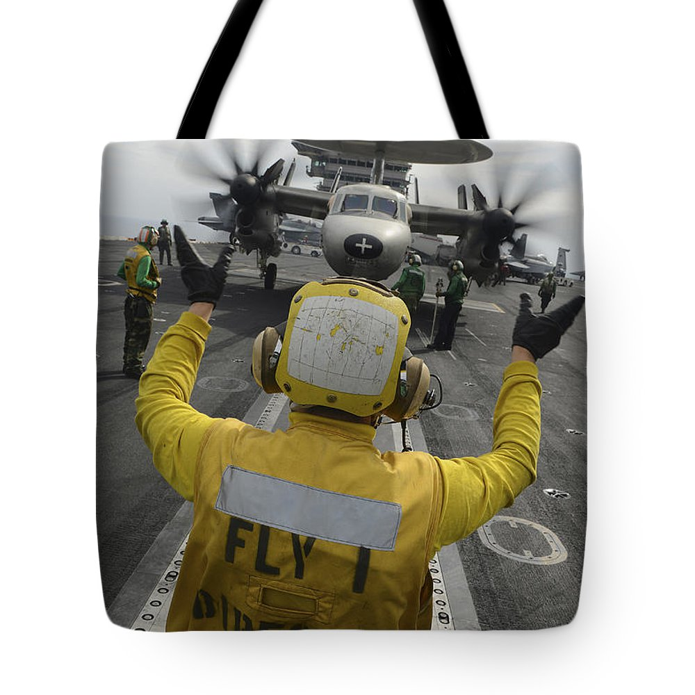 Military Tote Bag featuring the photograph Aviation Boatswains Mate Directs An by Stocktrek Images