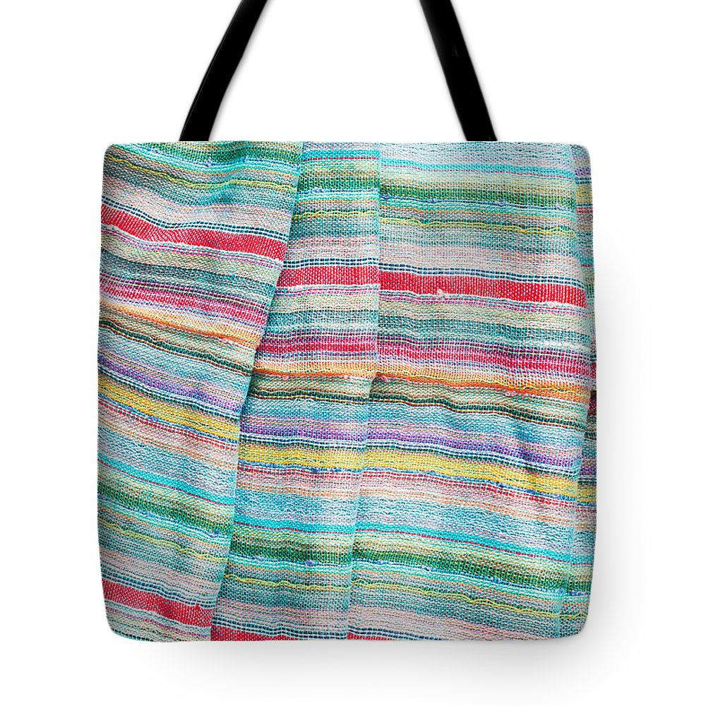 Backdrop Tote Bag featuring the photograph Colorful Cloth by Tom Gowanlock