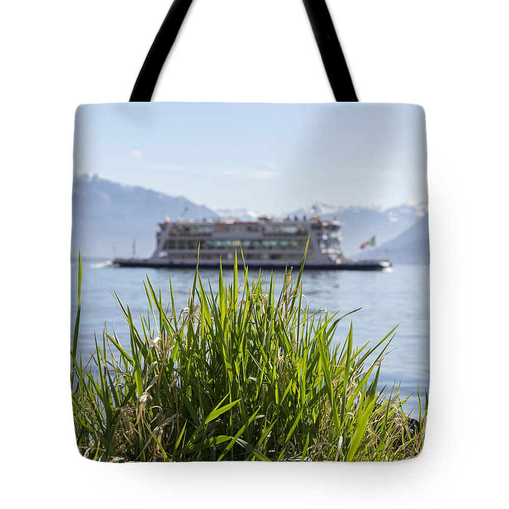 Passenger Ship Tote Bag featuring the photograph Passenger Ship On An Alpine Lake by Mats Silvan