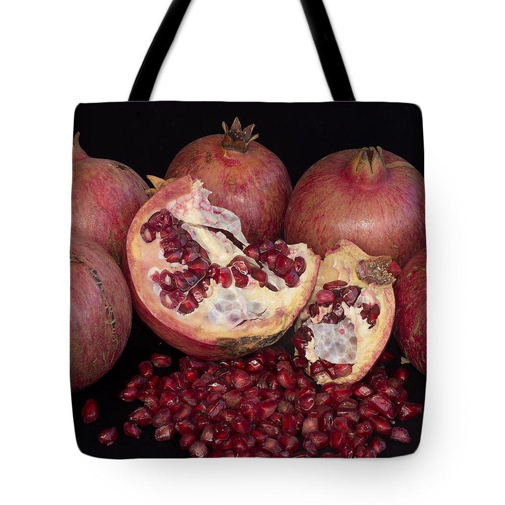 Pomegranates Tote Bag featuring the photograph Pomegranates by Manolis Tsantakis