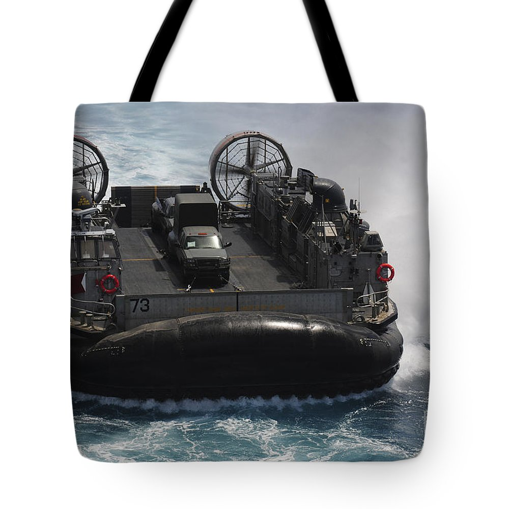 Rimpac Tote Bag featuring the photograph A Landing Craft Air Cushion Prepares by Stocktrek Images