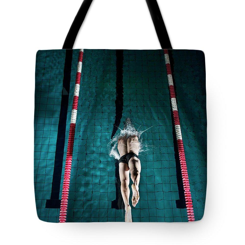 Copenhagen Tote Bag featuring the photograph Professional Swimmer by Henrik Sorensen