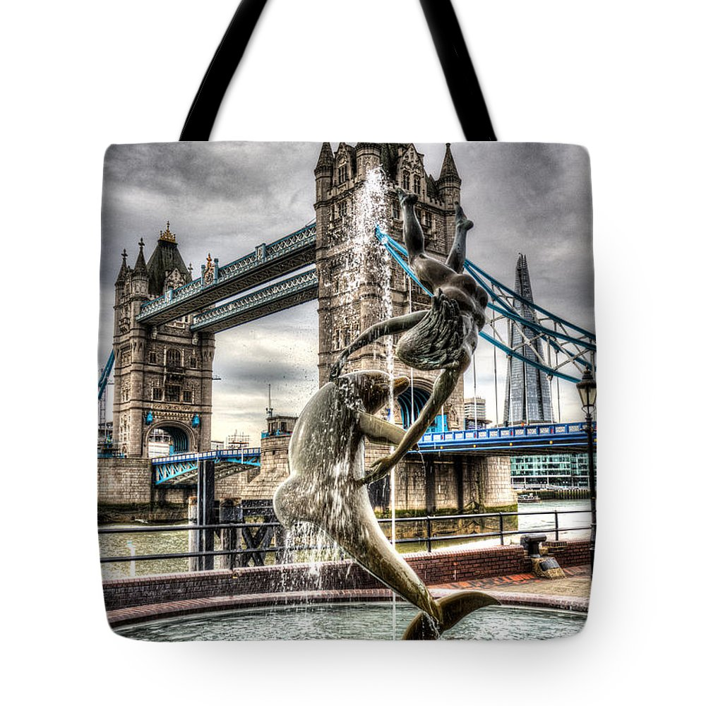 Tower Bridge Tote Bag featuring the photograph Tower Bridge And The Girl And Dolphin Statue by David Pyatt