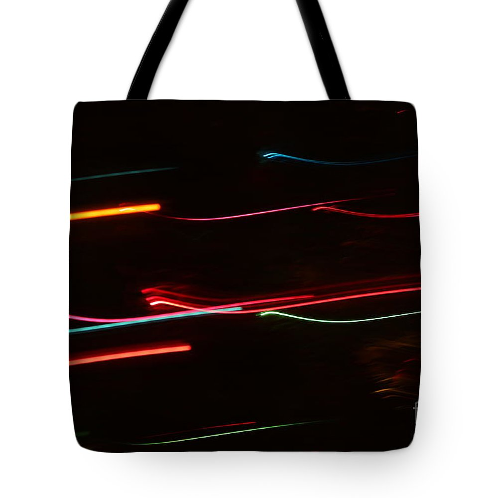 Abstract Tote Bag featuring the photograph Abstract Motion Lights by Henrik Lehnerer