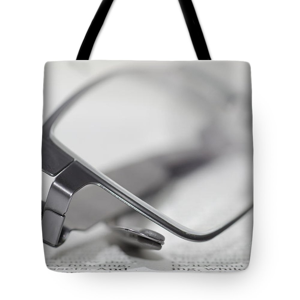 Finance Tote Bag featuring the photograph Eyeglasses by Mats Silvan