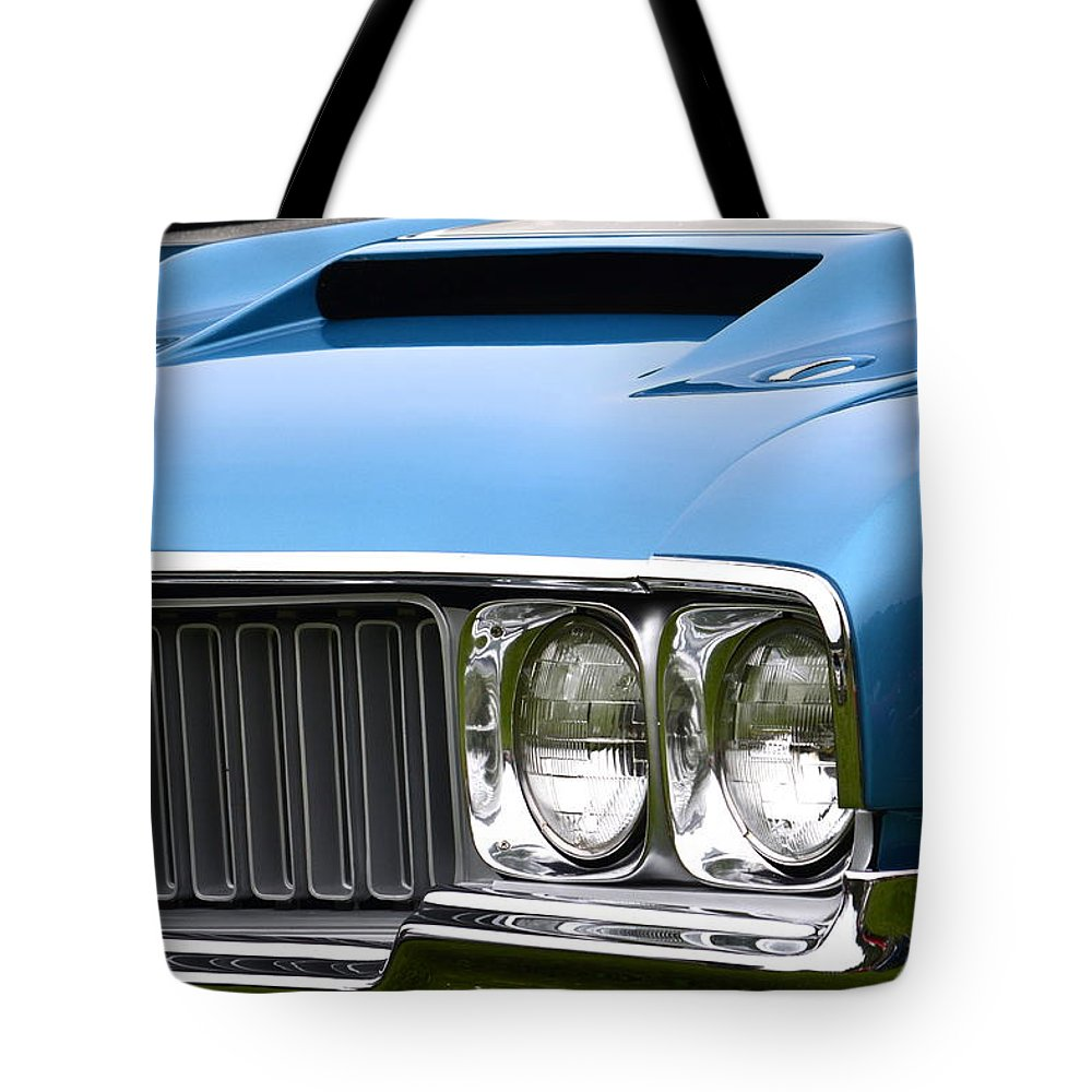 Tote Bag featuring the photograph 60's Oldsmobile 442 by Dean Ferreira