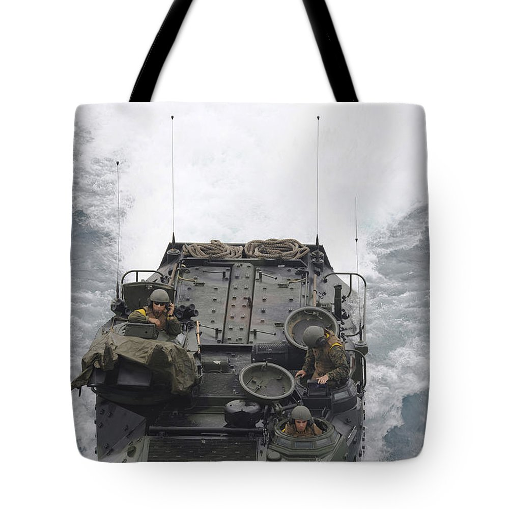 Military Tote Bag featuring the photograph An Amphibious Assault Vehicle by Stocktrek Images