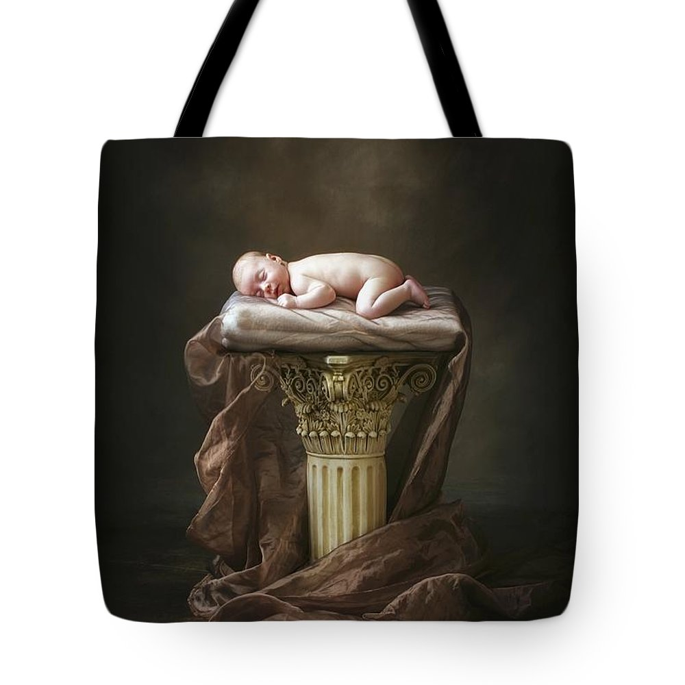 Pillar Tote Bag featuring the photograph A Baby Asleep On A Pillar by Pete Stec