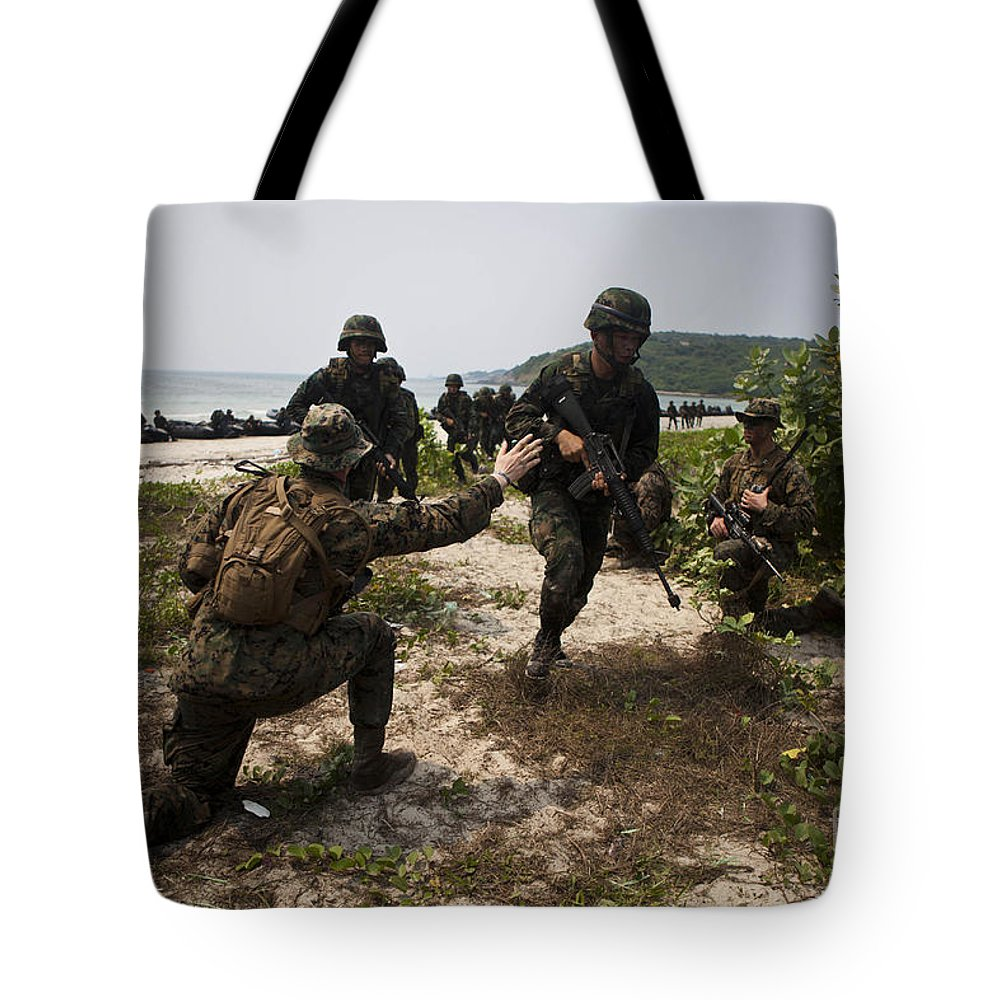 Military Tote Bag featuring the photograph A Bilateral Boat Raid With U.s. Marines by Stocktrek Images