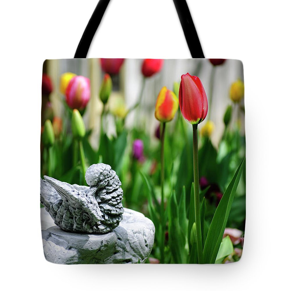 Tulip Tote Bag featuring the photograph A Bird And A Tulip by Diego Re