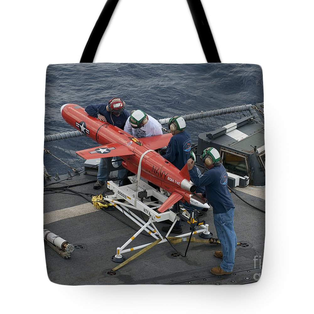 Military Tote Bag featuring the photograph A Bqm-74e Drone Is Prepared For Launch by Stocktrek Images