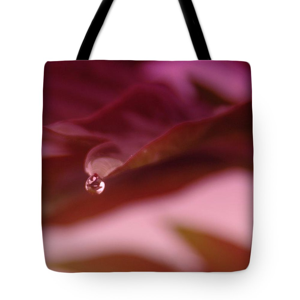 Waterdrops Tote Bag featuring the photograph A Calm Drop In Chaos by Jeff Swan