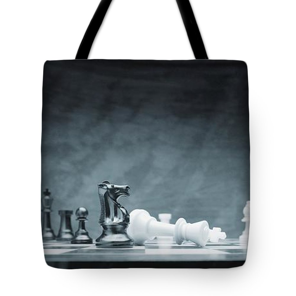 Achievement Tote Bag featuring the photograph A Chess Game by Don Hammond
