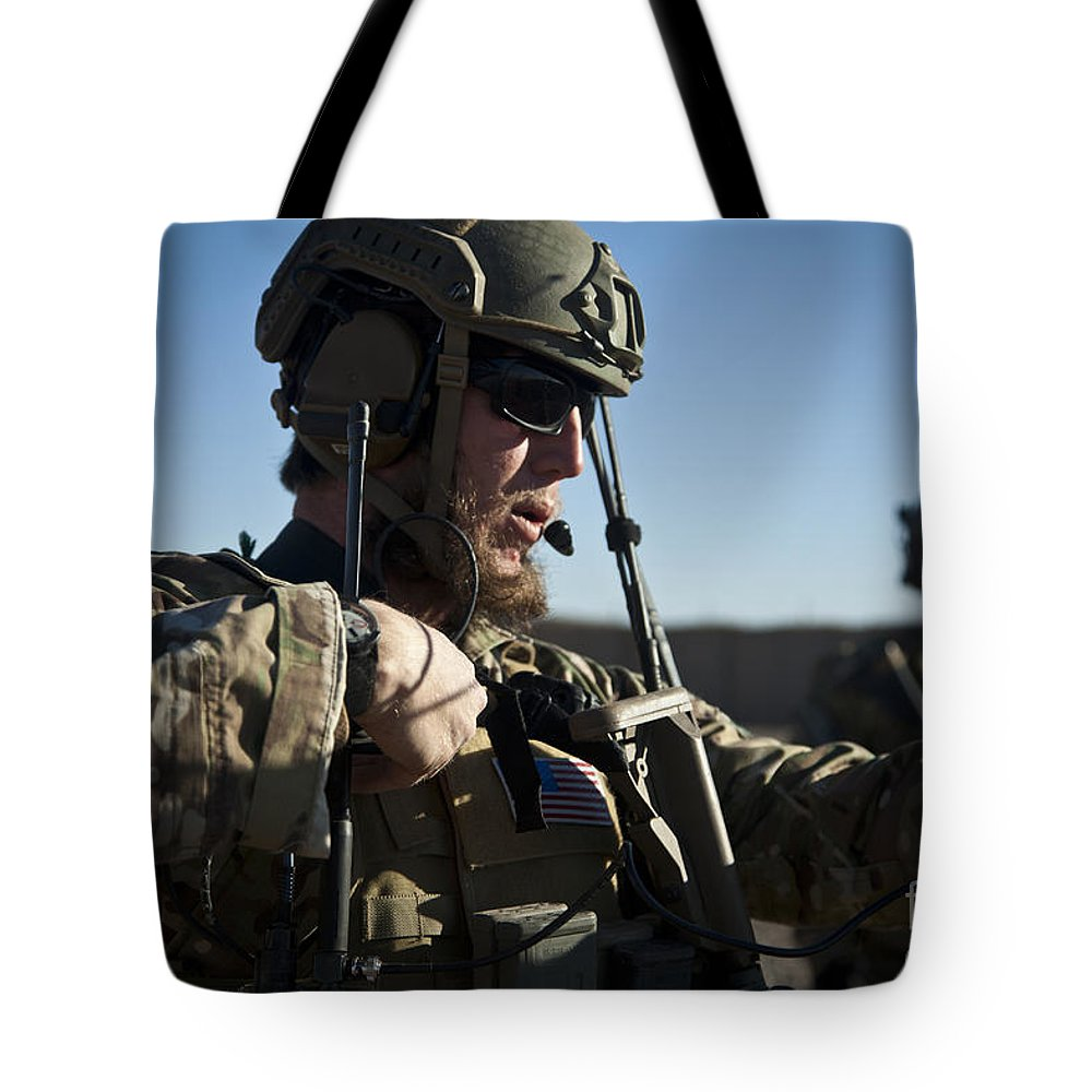 Afghanistan Tote Bag featuring the photograph A Coalition Force Member Sets by Stocktrek Images